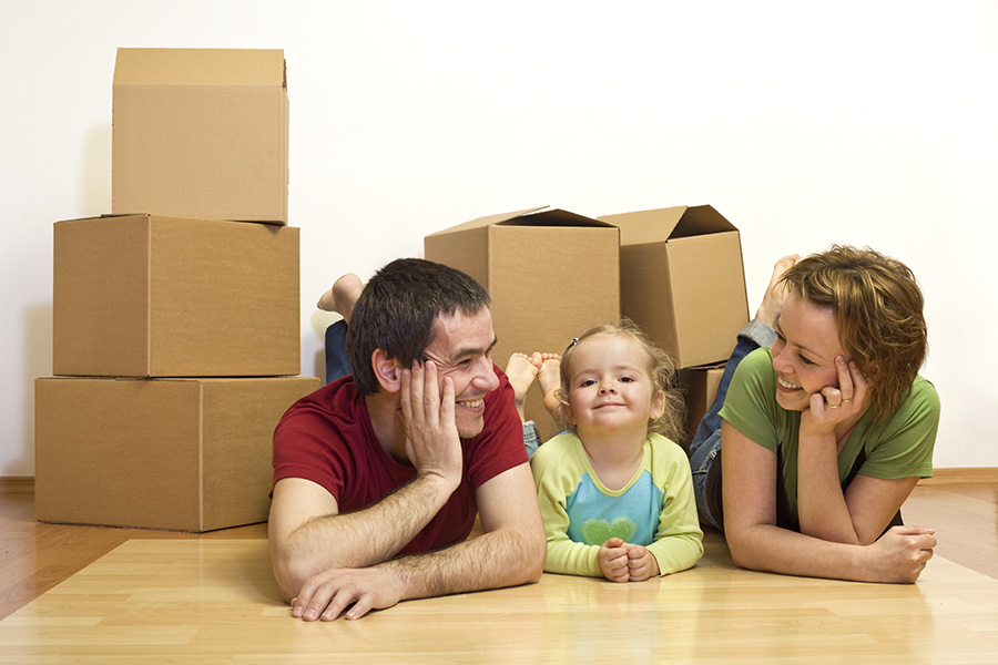family with boxes smiling